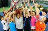 kids group playing tennis.jpg